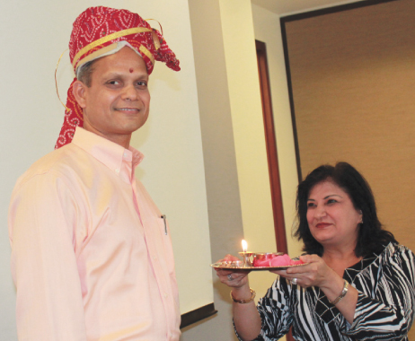 Rita Gulati gives Shekher Agarwal, a traditional Hindu send off.