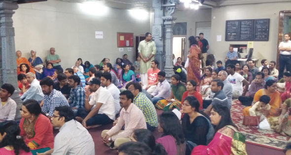 Devotees at Meenakshi temple listening intently to the panchangam reading at Meenakshi temple Ughadi puja.