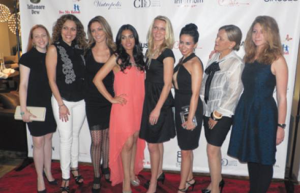 Nina Magon (fourth from left) with members of the cast of American Home Builders and other guests at the reception thrown in her honor at Internum Design on Kirby Drive on Thursday, April 17.