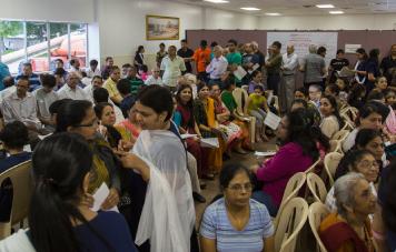 BAPS Charities visitors wait to get routine health checks.