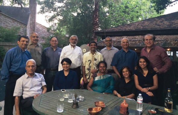 The founding members of the Connoisseurs Club in the tropical backyard setting of Atul Vir's (standing, fourth from right) home on Friday, April 25, 2014.