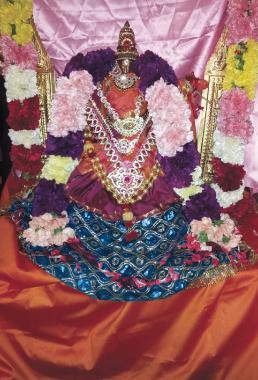 Utsava Vigraha of Sri Vasavi beautifully adorned at the pooja.