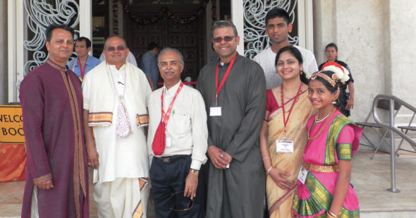 In front of the entrance to the temple were (from left) Chirag Bhatt, volunteer; Shyamsunder Das (Hamukh Patel), Temple President; Bharat Patel, Temple Treasurer, Sunil Shenoy and his wife Sandhya, son Sreesh and daughter Sneha, all of whom volunteered for fundraising.