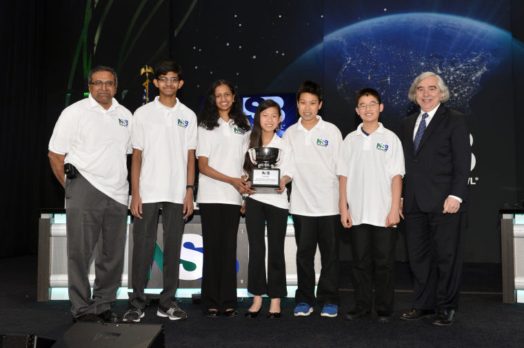 U.S. Department of Energy Secretary Ernest Moniz (right) poses with the Greater Boston Science & Math Team from Andover, Mass., which won first place in the middle school competition at the National Science Bowl in Washington, D.C., April 28. Coach Ravi Sambangi (at left) poses with team members Abhi Sambangi, Snigdha Allaparti, Alice Ren, Michael Ren and Justin Chang (U.S. Dept. of Energy photo by Jack Dempsey.)