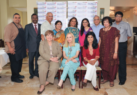 The speakers with some of the IACF Board of Directors. Standing from left, Chef Kiran Bheemarao, President Ramesh Cherivirala, Abhijit Gadgil, Rathna Kumar, Alpa Shah, Vanitha Pothuri, Prem Cholia, President-Elect Kamala Raghavan and Past-President Murthy Divakaruni. Seated, from left: Mary Ann Craig, CEO, Kindred Hospital Northwest; Carolyn Farb, philanthropist, author and art collector and Dr. Latha Ramchand, Dean, Bauer College of Business, University of Houston.                Photos: Bijay Dixit
