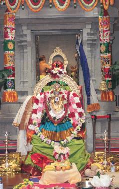 Resplendent in alankara with Golden bricks Mahalskmi seated majestically in front of Ganesha sannadhi.
