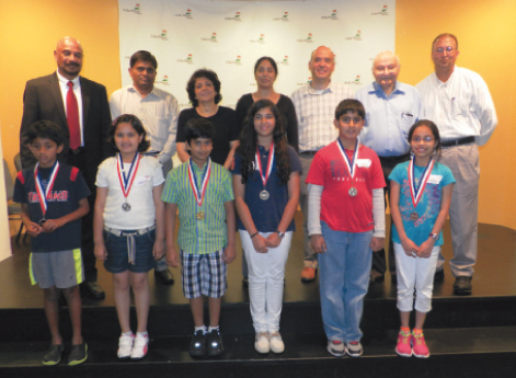 The finalists posed for pictures with the judges, emcee and sponsors on Saturday, May 31 at India House.