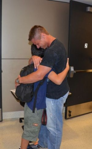 Dean Drees reunites with his son, Drew, July 9 at Dallas-FortWorthInternationalAirport. Drew's mother, Padmashini Drees, kidnapped him and took him to India for the past eight years, according to police. (MPD courtesy photos)