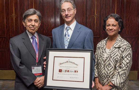 Dr. Ninan T. Mathew (left), with Dr. Lawrence C. Newman, President of the American Headache Society (center), and Sushila Mathew at the American Headache Society's annual scientific meeting in Los Angeles on June 27.