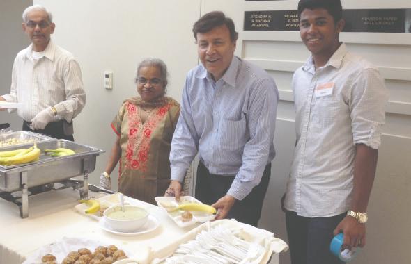 Mahesh Shah helped serve the breakfast that his restaurant Madras Pavilion had sponsored for Desi Grandparents Day
