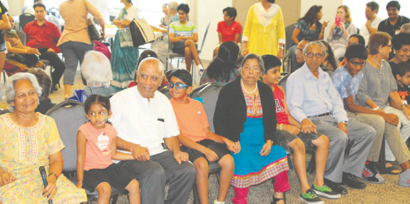 Kids with their grandparents waited between stops of the Musical Chairs contest.