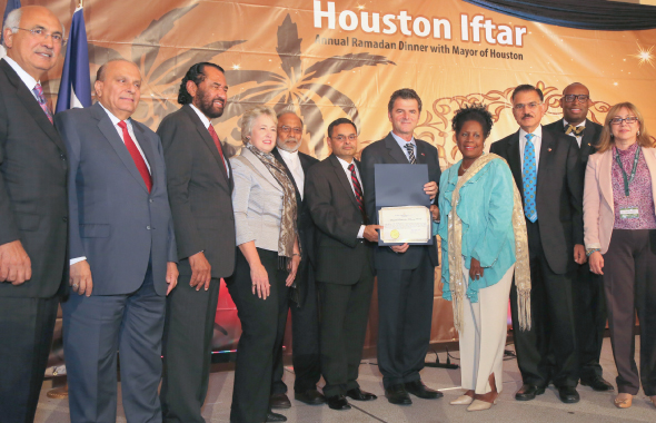 At the Mayor's Annual Iftar Dinner, Congresswoman Sheila Jackson Lee (center) presented the Certificate of Congressional Recognition to Chairman Ruhi Ozgul, and Event Coordinator Saeed Sheikh as (from left) M. J. Khan, S.Javaid Anwar, Congressman Al Green, Houston Mayor Annise Parker, Sunil Sharma and two City Councilmembers look on.