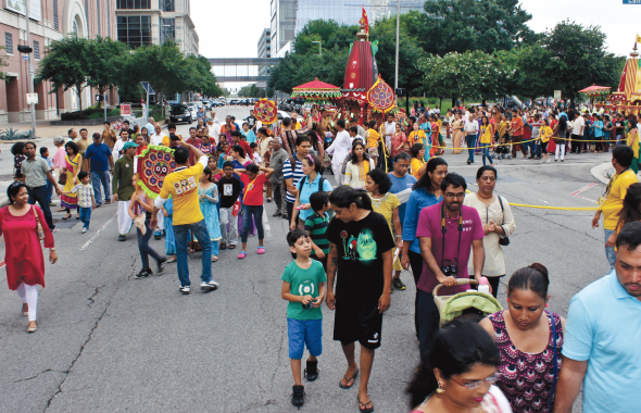 Lord Jagannath being carried on his Divine Journey, crafted  by SKAI Foundation and hand pulled by hundreds of devotees from all corners of Texas, through 10 Downtown Houston city blocks on Saturday, June 28.