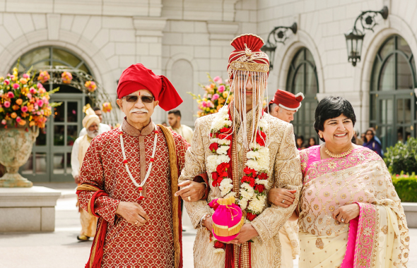 The groom Abhishek arriving at the mandap in courtyard of the Grand America escorted by his parents.  Photos: Nadia D. Photography