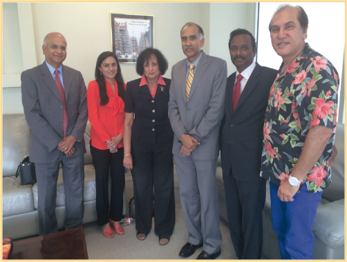 The Indo American Charity Foundation Executive Committee and Board Directors paid a courtesy visit on Indian Consul General Parvathaneni Harish on Friday, August 1 at his office. Flanking Harish (third from right) are, from left, Abhijit Gadgil, Vanitha Reddy Pothuri, President-Elect Kamala Raghavan, President Ramesh Cherivirala and Jawahar Malhotra.