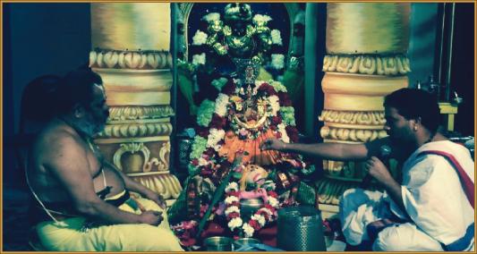 Puja for Sri Lakshmi during Varalakshmi Vritham at the Meenakshi temple with Priests Sri Sridharan Raghavan and Sri Pawan Kumar.
