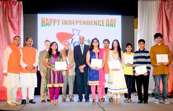 From left, ICC Trustee Swapan Dhairyawan who himself recieved a Lifetime Community Award and Event Chair Rajiv Bhavsar, with Indian Consul General Parvathaneni Harish (in suit, center) with the students who received achievement awards at the IFest held last Saturday.