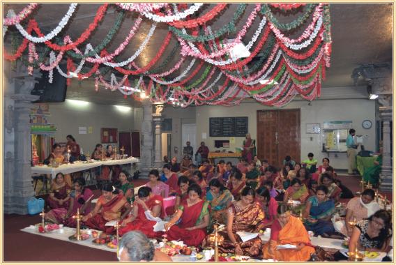 Ladies partaking in the Aadi Ashtalakshmi Pooja at Sri MTS