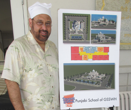 The architect of the Gurudwara and the Punjabi School, Hardeepak Munday poses with a rendering of the building.
