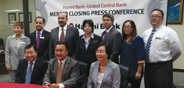 From left (seated): Joseph K. Rho, Chairman of the Board, C. G. Kum, President & CEO, and Bonnie Lee, COO of Hanmi Bank with employees of the former United Central Bank branch on Gessner, addressing a press conference in Houston on Friday, Sept 4.