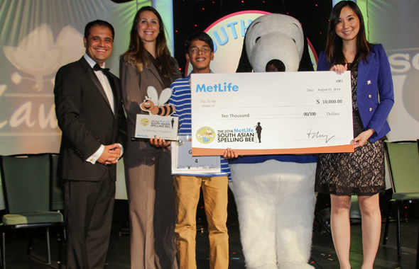 From left: Rahul Walia, Founder of the South Asian Spelling Bee; Hayley Freundlich, Director, Diverse Markets and Marketing Support, MetLife; 2014 MetLife South Asian Spelling Bee National Champion Gokul Venkatachalam of Chesterfield, MO with with MetLife brand icon Snoopy and Candy Chan, Sr. Marketing Consultant, Diverse Markets, MetLife.