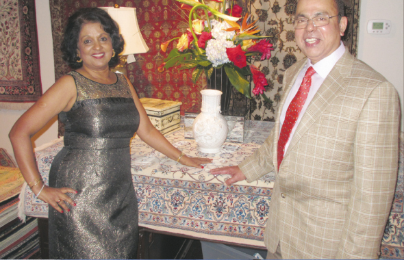 Sam and Omana Abraham at the grand opening of their new showroom on Bartlett Street in the Kirby-Rice Village area.