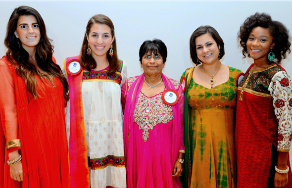 Sewa International Houston President Sarojini Gupta (center) with the Americorps volunteer interns.