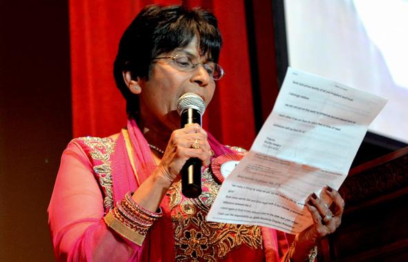 Sewa International Houston President Sarojini Gupta delivers her speech.