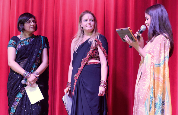 The emcees, Priyanka Desai of Music Masala radio show and Chrictine Dobbyn (centered), reporter with KTRH-ABC Channel 13 TV being introduced onstage.