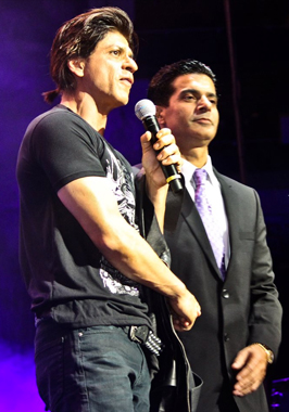 Rajender Singh of Star Promotion Inc. with Shah Rukh Khan during the SLAM tour concert in Houston on Friday, September 19.