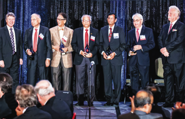 ASIE Class of 2014 Award winners on stage, from left, Dr. Durga Das Agrawal, Ram Gupta, Sam Kannappan, Showri Nandagiri, and Randhir Sahni with presenters Harris County Judge Ed Emmett (extreme left) and Jimmie Schindewolf, General manager of NHCRWA (extreme right).