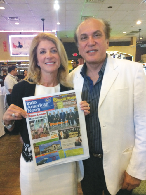 State Senator and Democratic Gubernatorial candidate Wendy Davis with Indo-American News PublisherJawahar Malhotra and a recent copy of the newspaper at a fundraiser in Houston last Sunday, October 5.