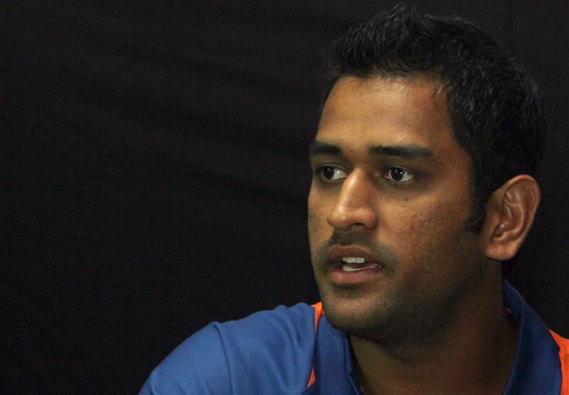 Indian cricket team's captain Dhoni speaks during news conference in Mumbai