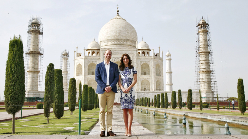 Britain's Prince William and his wife Catherine, the Duchess of Cambridge, pose in front of the Taj Mahal in Agra