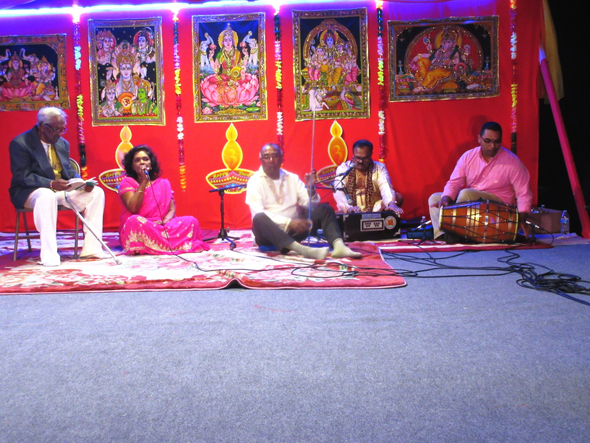 Towards the end of the evening, Shomie Ram Persaud (on the mic), Ram Sharma (on harmonium) and a group of others sang some bhajans.
