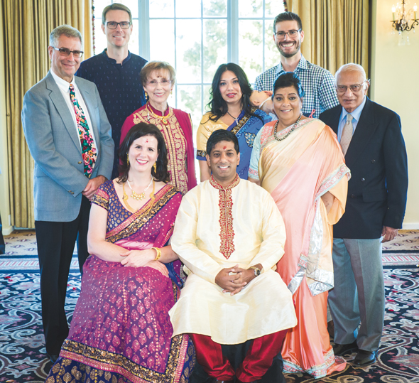 At the reception for the newly engaged couple (center) Dr. Vishal Nigam and Carrie Rhodes, from left, her dad Scott, mom Jean, his sister Anjali, mom Kamlesh and dad Dr. Mool Nigam. In the back are Carrie's brothers Jamie (left) and George.  Photo: Harsh & Sayani Mahadeshwar