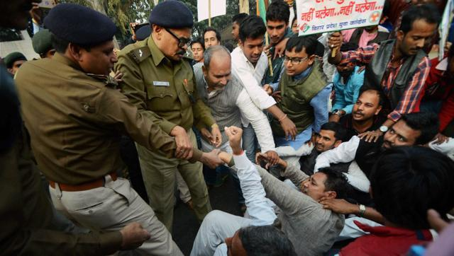 Police detain Youth Congress workers during a protest against the demonetisation exercise, in Patna on Sunday. (PTI)