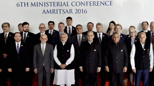 Prime Minister Narendra Modi, along with Afghanistan's President Ashraf Ghani, finance minister Arun Jaitley and other delegates, poses for a group photo before the inauguration of the 6th Heart of Asia Ministerial Conference. (PTI Photo)