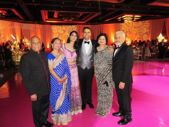 The newlyweds Bobby and Neha Kathuria with their parents Brij and Aruna Kathuria (on right) and Sharad and Bharti Purohit (on left) at their wedding reception.