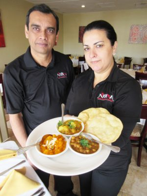 Nirvana Restaurant manager Jakir Hossain and waitress Noemi Gamez with the weekend puri, aaloo, chole and halva platter that is the Indian breakfast of Champions!!
