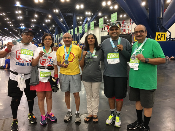 Indo American participants in Half Marathon with finisher medals. From left: Ramesh Anand, Zarina Anand, Pankaj Desai, Riddhi Desai, Chintan Mehta, and Sesh Bala.