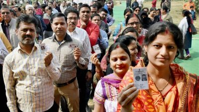 Voters queue up to cast their votes during the third phase of the UP assembly elections in Lucknow on Sunday. (PTI)