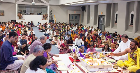 Maha Mrtyunjaya Homam offered by a multitude of devotees for the health and spiritual prosperity of the world at large.
