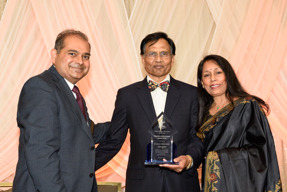 "IDA president Manish Gandhi (left) presented the ""Physician Achievement"" award to Drs. Suresh and Sunita Moonat for their pioneering work to establish the IDC Charity Clinic."