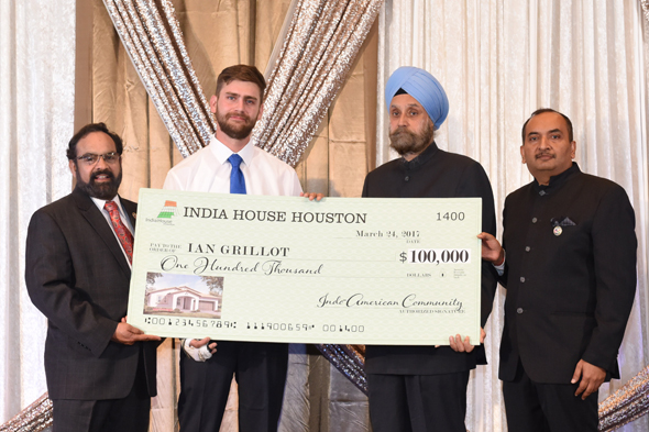 Ian Grillot (second from left) receives a check for $100,000 from India House Houston trustee Charlie Yalamanchili (left) and India House Gala Chair Jiten Agarwal (far right) in the presence of Indian Ambassador toU.S. Navtej Sarna.