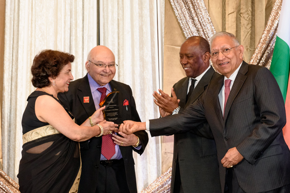 Dr. Virendra Mathur and Nalini Mathur being presented the Life Time Achievement award by Mayor Sylvester Turner and Dr. Durga Agrawal (right).