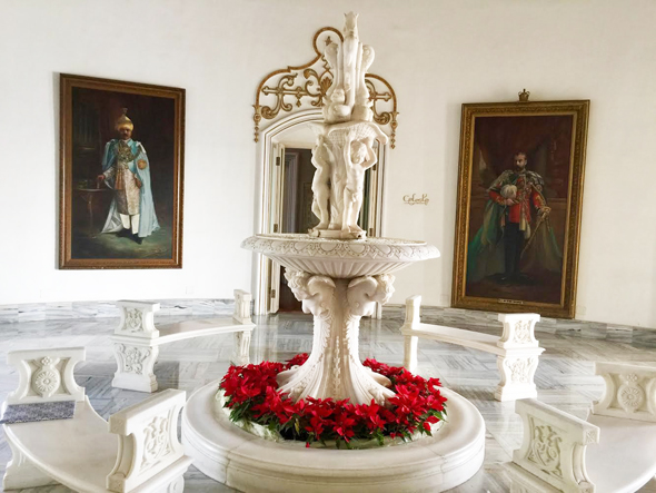 The interior of what is now Taj Falaknuma Palace. The palace was built of white Italian marble and there are majestic portraits of the various Nizams.