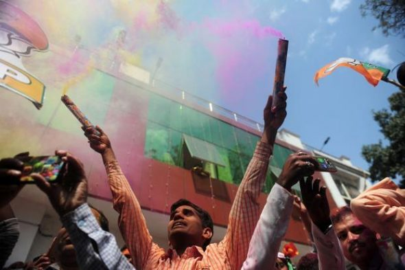 The Uttar Pradesh election results, where the BJP and its allies won 325 out of 403 seats, shows that there has indeed been a 'regime change' in the politics of the state. Photo: AFP