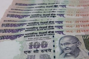 The rupee opened at 65.40 a dollar and touched a high and a low of 65.21 and 65.44, respectively. Photo: HT