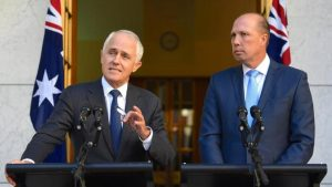 Australia's Prime Minister Malcolm Turnbull speaks as Immigration Minister Peter Dutton listens on during a media.(Reuters photo )
